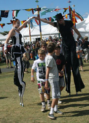 stilt walkers performance at a folk festival, Australia