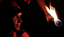 fire juggler and fire eater performing a fire circus show in Australia